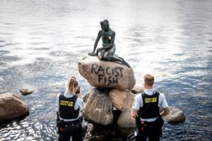 'Racist Fish' graffiti tagged on the Little Mermaid in Copenhagen. Photo credit to The Local